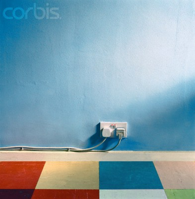Cords in Outlet Along Blue Wall --- Image by © Dirk Lindner/CORBIS